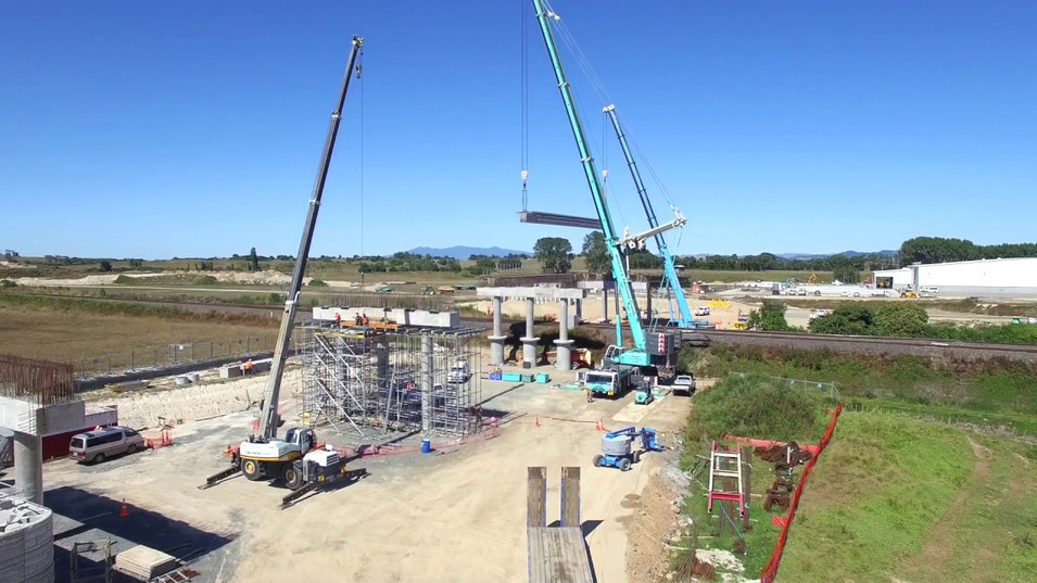 Drone video montage of a bridge being assembled