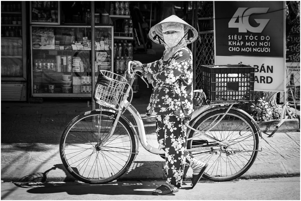 Vietnamese woman with bicycle
