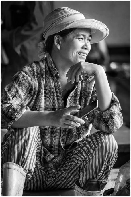 Vietnamese farmer at the fish market