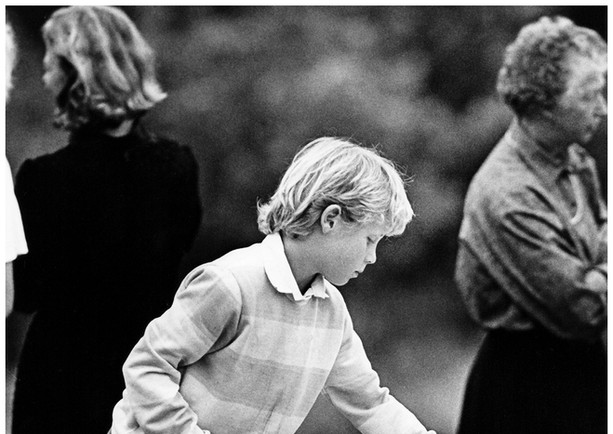 Child at family funeral
