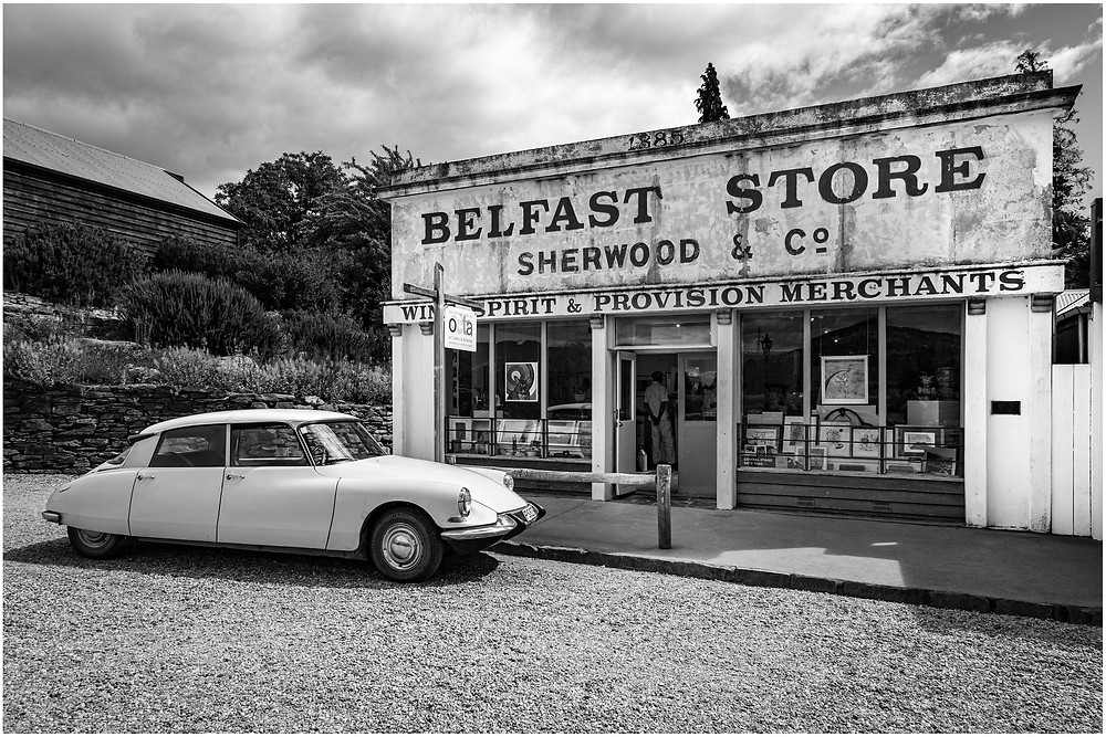 A classic Citroen car is parked outside the Belfast store, in the historic precinct of Cromwell, New Zealand