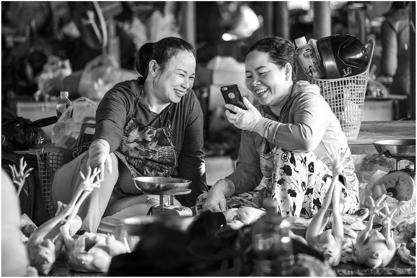 Vietnamese ladies laughing at the farmers market
