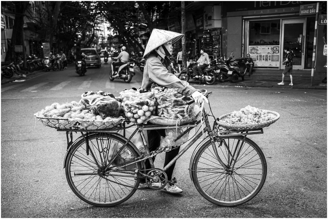 Vietnamese bicycle fruit and veg seller, hanoi