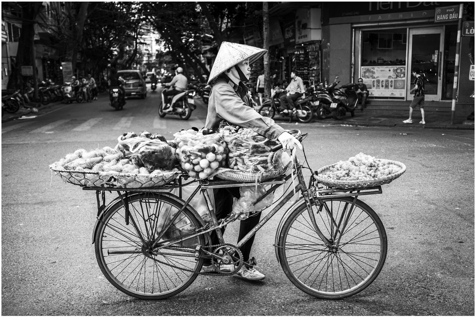 Vietnamese bicycle fruit and veg seller, hanoi