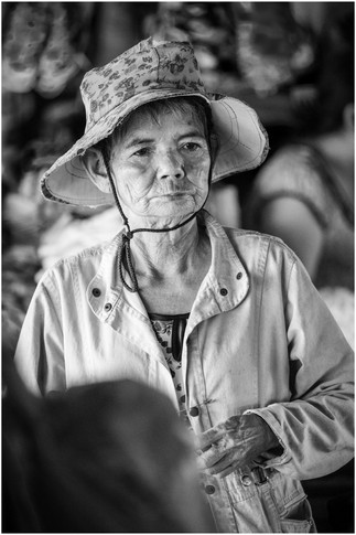 Old Vietnamese woman at the flower markets