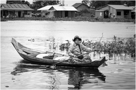 Cambodian woman in boat