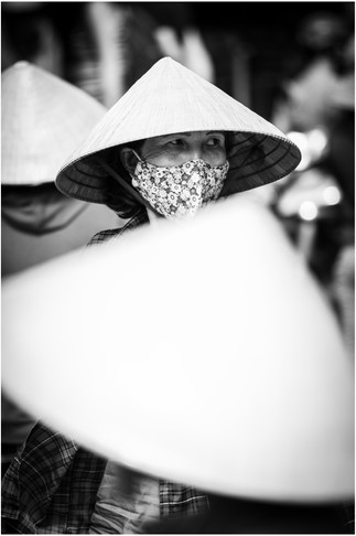 Vietnamese woman wearing traditional conical rice hat