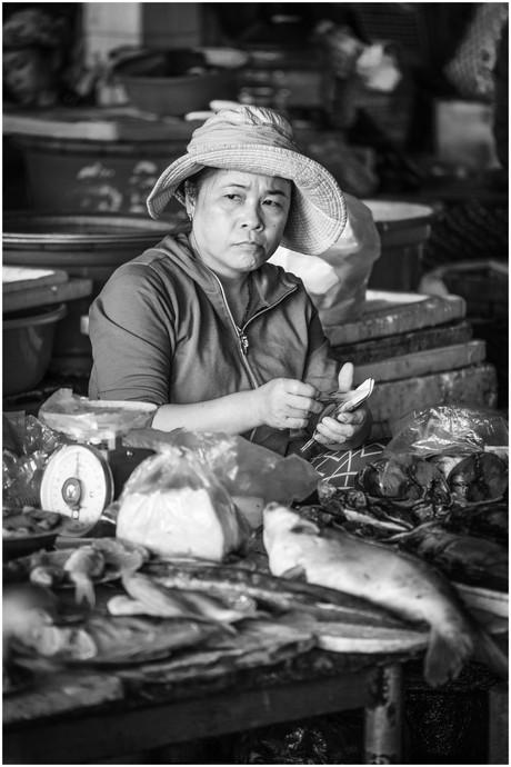 Vietnamese market woman counting money