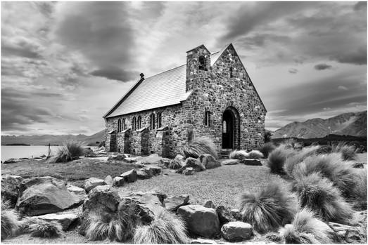 Lake Tekapo stone church and tussock grass...