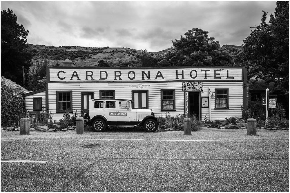Historic Cardrona Hotel with matching vintage car parked out front