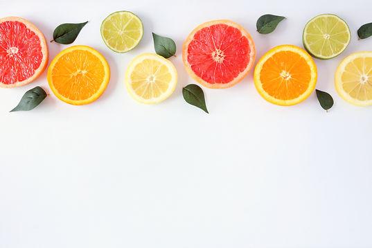 Colorful fruit border of fresh citrus sl