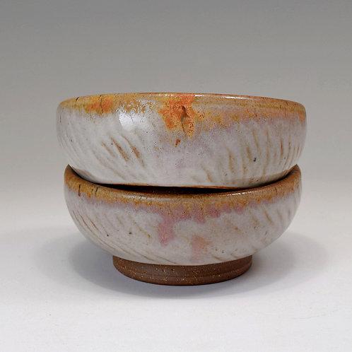 Pair of chattered ice cream bowls, Shino glaze