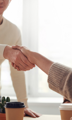 Two business people shaking hands background