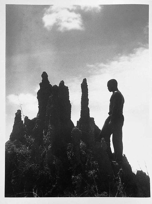 Liberia: Liberian in front of a Termite Hill, circa 1930