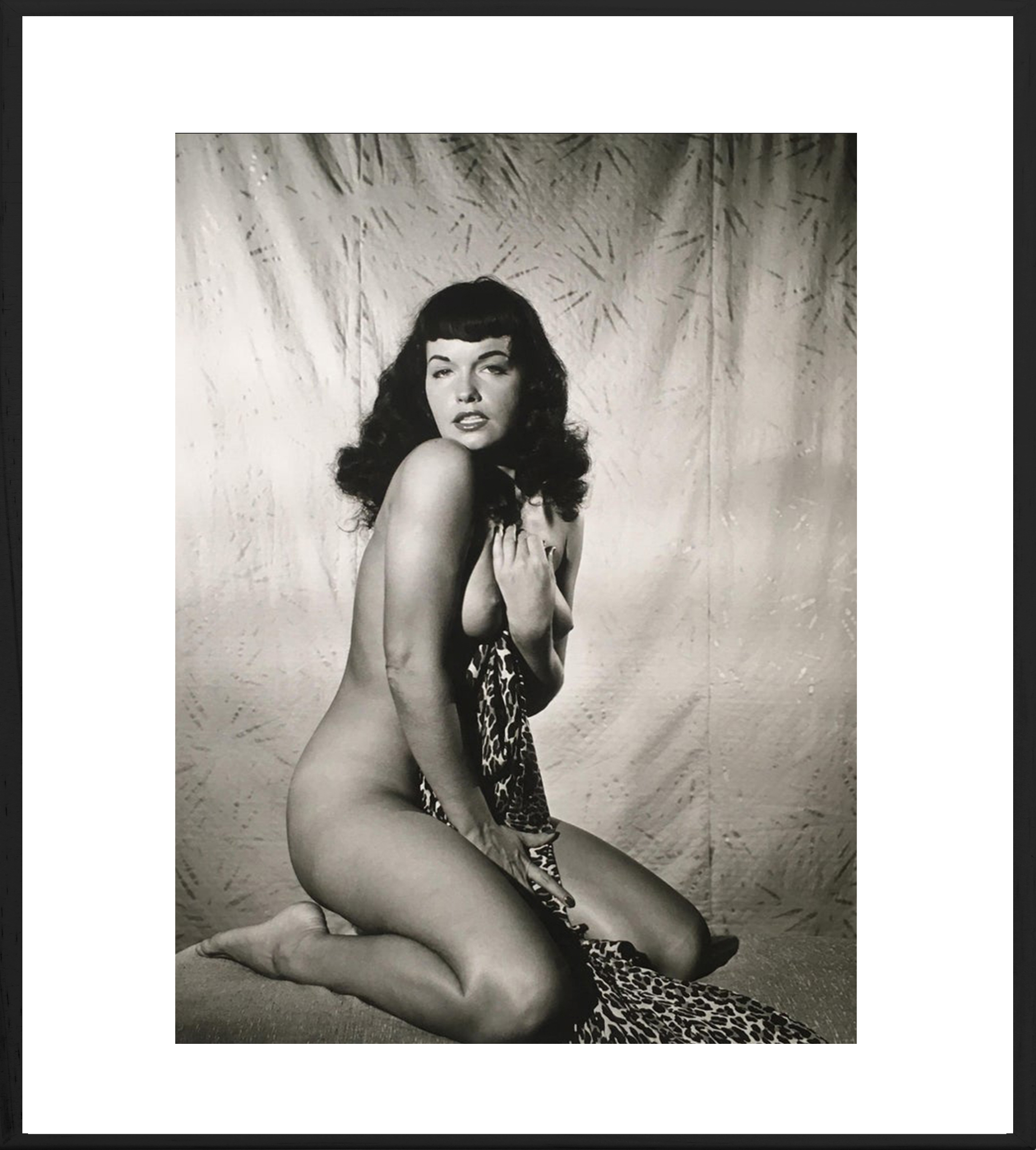 Bettie Page Clutching Robe, 1954