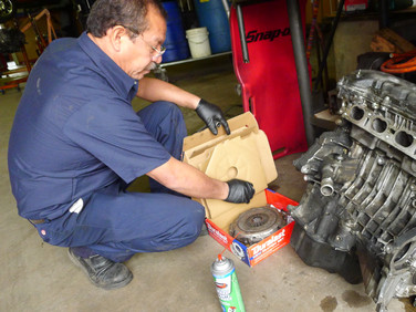 Inspecting an engine that was damaged from no oil.