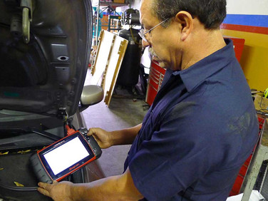 Running diagnostics on an engine to pinpoint problems.