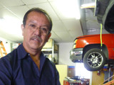Francisco rebuilding a Ford Explorer engine.