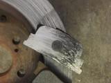 Before image of badly worn brake rotors and pads.