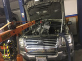 Removing the engine from a Ford Explorer for a valve job.