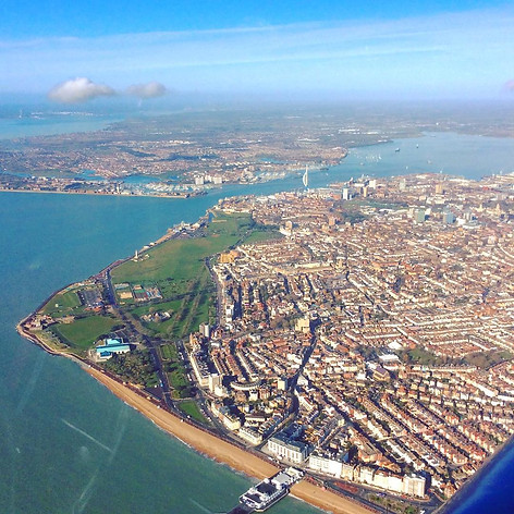 G-BKDH over Southsea Seafront