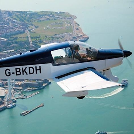 G-BKDH over Portsmouth