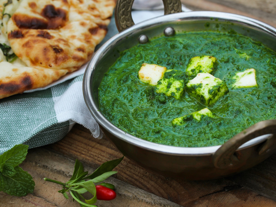 Palak Paneer with Naan served in Kadai,