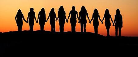 Women-holding-hands-Sunrise-silhouette.j