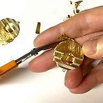 trimming 24k gold foil after Keum Boo.jpg