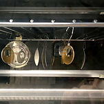 Jewelry pieces in oven, curing e-coating