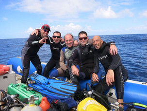 Group of friends and our dive master.jpg