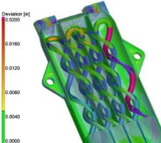 3D printed chemical reactor that has been CT scanned and the data overlaid with the CAD model showing deviations between the as-designed CAD and the as-print.d part.