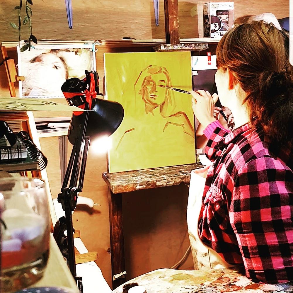 Tara Hanshaw Lewis painting painter in art studio female portrait rosemary brushes paint sketch oil bob ross funko pop pink flannel artist