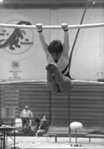 Barbara May competing on the uneven bars at the 1984 CWUAA (Canada West Universities Athletic Association) Gymnastics Championships