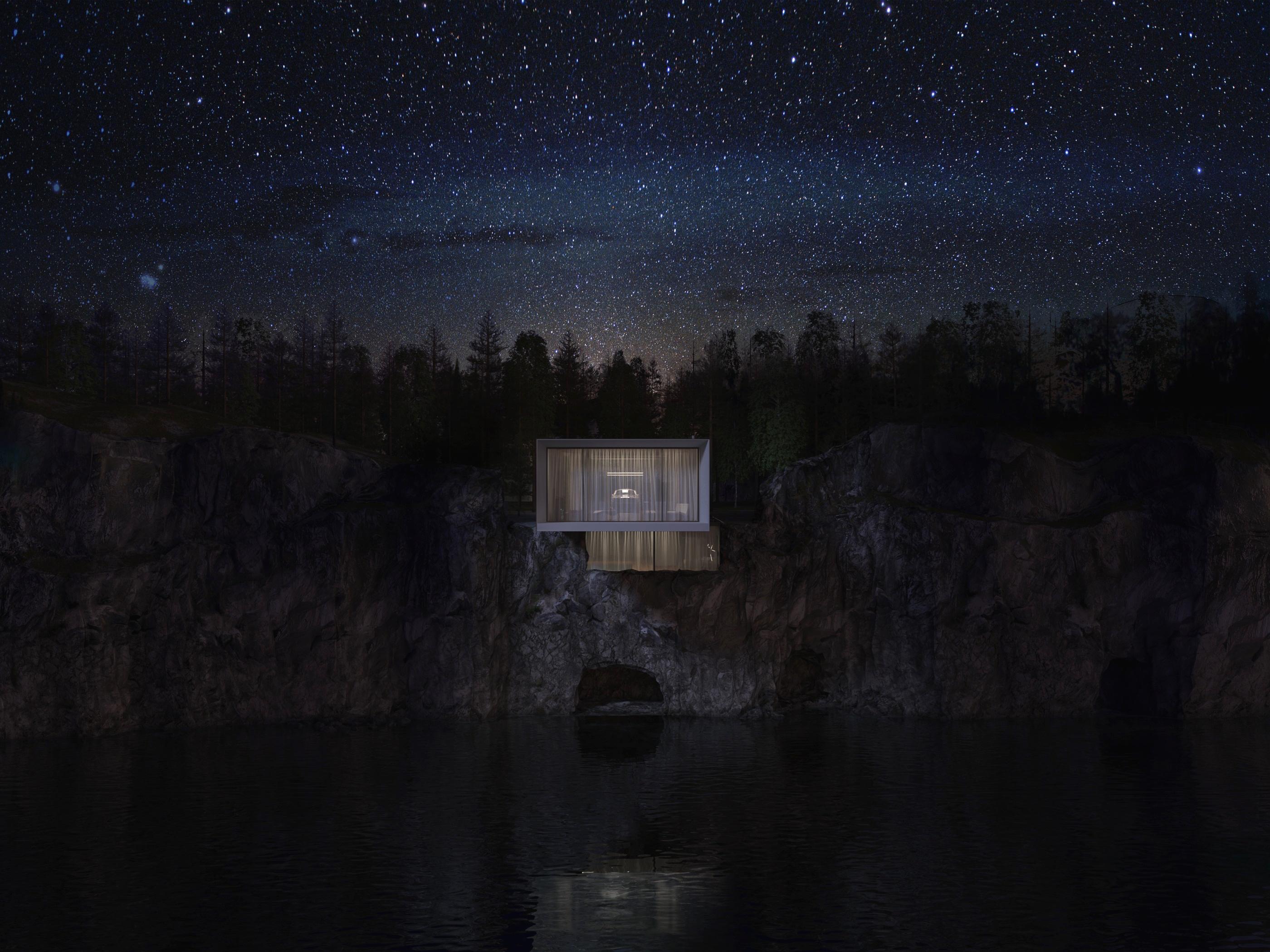 Ночной ракурс дома на скале