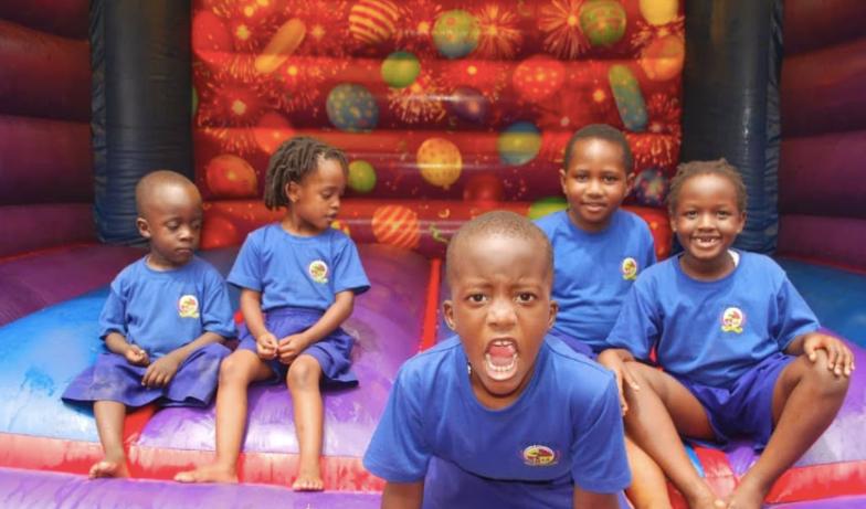 Preschool students in the bouncing castle