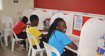 Students in their learning center offices