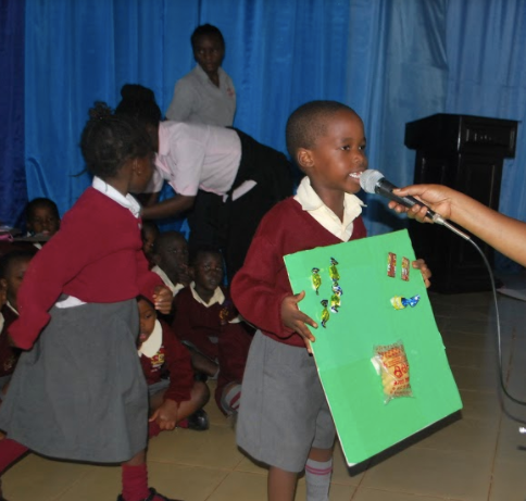 Preschool students present their art to an audience