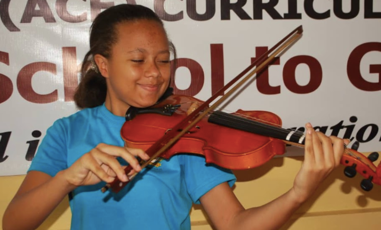 Student presenting her violin composition
