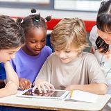 kids looking at tablet.jpg