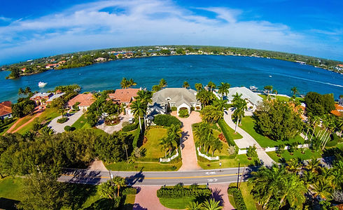 Subdivision in Florida located beside a lake Aerial skyline shot_edited.jpg