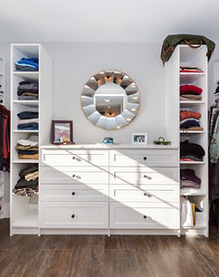 Custom made walk-in closet with hardwood floors