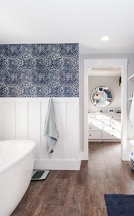 Custom modern bathroom with walk though closet and hardwoo floors