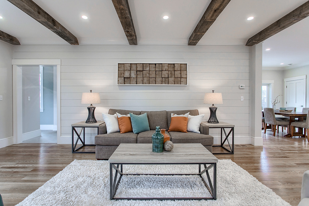 Living Room with custom features and reclaimed wood beams in new construction home in Newburyport, MA
