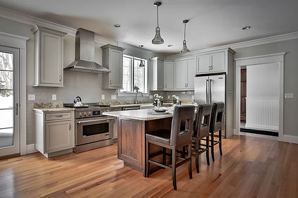 Custom Kitchen renovation with white cabinets and huge center island