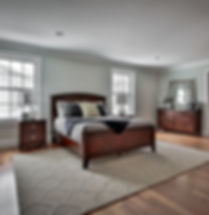 Master bedroom with dark wood furnirure and hardwood floors