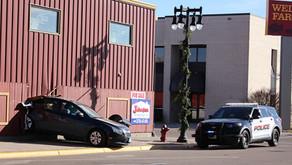 Vehicle backs through downtown Worthington business