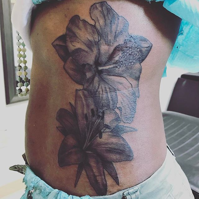 Knocked this out today #flowertattoo #hibiscus #hibiscustattoo #tigerlily #tigerlilytattoo #atlantat