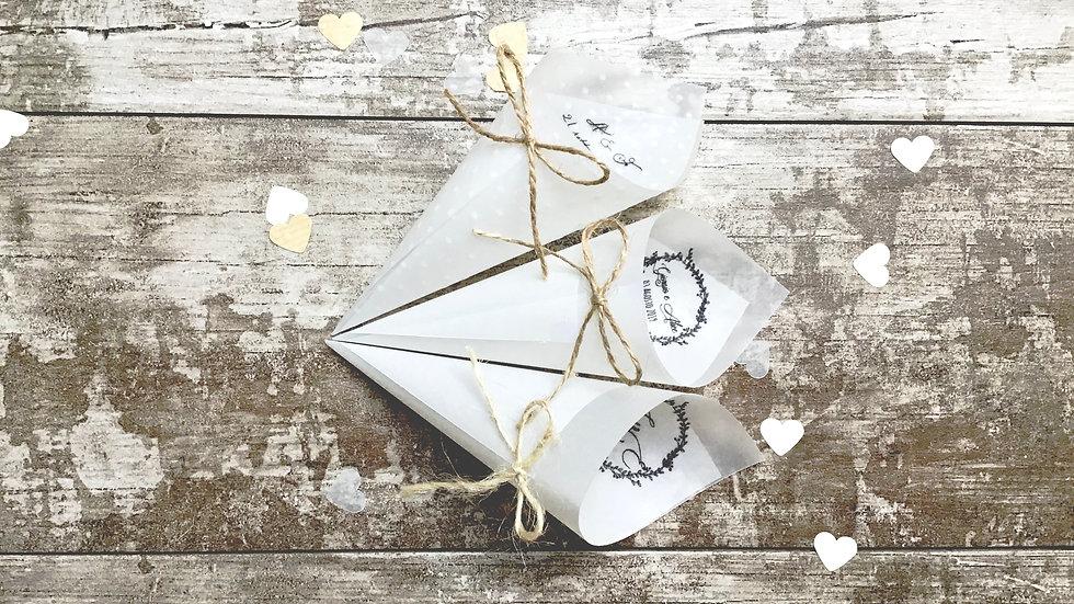 Conetti con fiocco + scritta in delicata carta trasparente