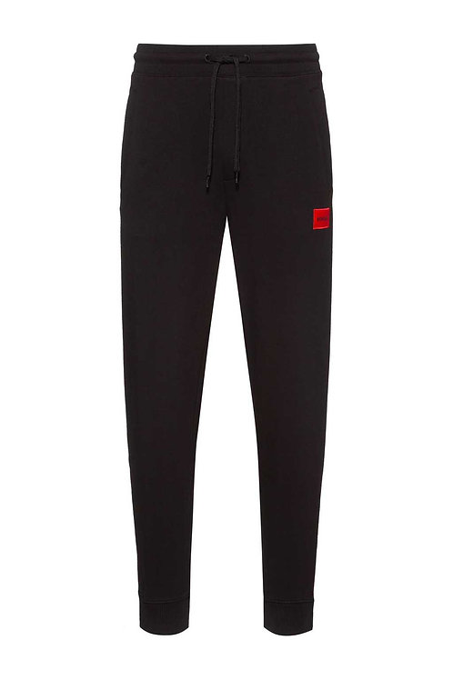 Cotton tracksuit bottoms with red logo patch in black